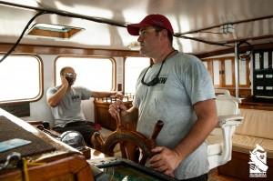 Dan Haefner steering the RV Odyssey