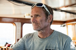 Captain Bob Wallace at the helm of Odyssey