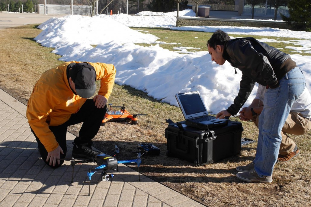 Professor Bennett and team member Rocco ('18), connecting Morticia to the ground station (the computer). This will enable flight data to be recorded, and failsafes to engage in case anything happens to the controller or radio during flight.